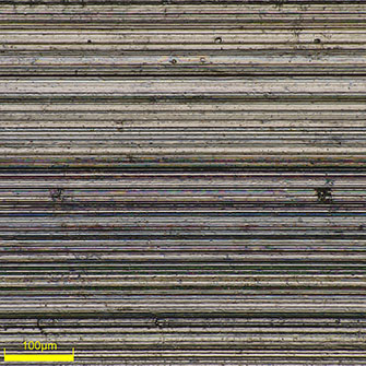 High-magnification (500x) image of the bottom of a piston ring groove. You can closely observe the machined state.