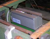 Olympus Innov-X on-line Fox-IQ XRF analyzer for metal tube and rod manufacturing quality control.