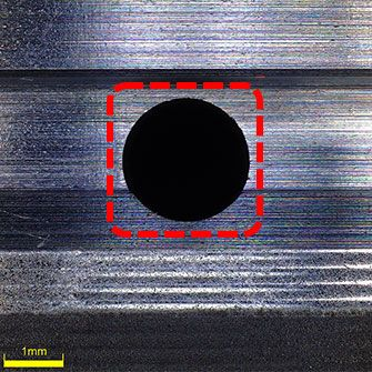 42x image focused on both the top and bottom of a groove using the omnifocal function. You can clearly see the edge of the cooling channel hole.